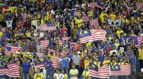 Malaysia fans wave Malaysian national flags in the stands before their semi final first leg match of the ASEAN Football Federation (AFF) 2010 soccer tournament against Vietnam in Kuala Lumpur December 15, 2010. REUTERS/Bazuki Muhammad (MALAYSIA   Tags: SPORT SOCCER)